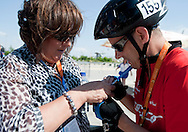 (L) Anna Komorowska - First Lady of Poland & (R) athlete Jacek Cieslik of SO Poland while cycling competition during 2011 Special Olympics World Summer Games Athens on June 27, 2011..The idea of Special Olympics is that, with appropriate motivation and guidance, each person with intellectual disabilities can train, enjoy and benefit from participation in individual and team competitions...Greece, Athens, June 27, 2011...Picture also available in RAW (NEF) or TIFF format on special request...For editorial use only. Any commercial or promotional use requires permission...Mandatory credit: Photo by © Adam Nurkiewicz / Mediasport