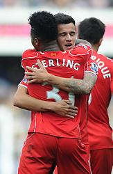 Liverpool's Philippe Coutinho celebrates his goal with Liverpool's Raheem Sterling - Photo mandatory by-line: Dougie Allward/JMP - Mobile: 07966 386802 - 19/10/2014 - SPORT - football - London - Loftus Road - QPR v Liverpool - Barclays Premier League