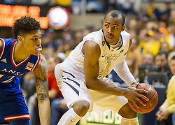 West Virginia Mountaineers guard Jevon Carter (2) looks to get past a defender against the Kansas Jayhawks during the second half at the WVU Coliseum.