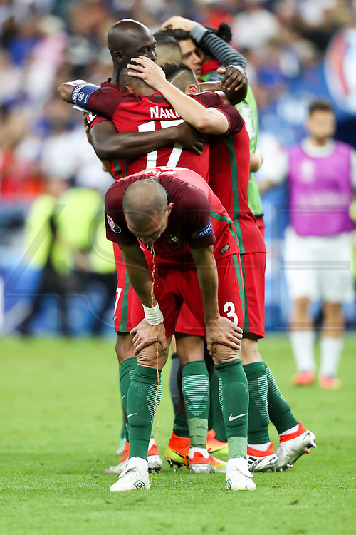Portuguese player Pepe vomiting after feeling sick during the match that opposed Portugal and France at the Euro Cup final at Saint Denis stadium in Paris.