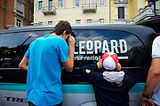 These kids tracked down Cancellara after the prologue and enjoyed watching him change his shoes through his van's tinted windows.