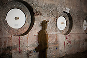 A shadow falls on a wall containing stored radioactive waste 2150 ft underground inside The Waste Isolation Pilot Plant in Eddy County. WIPP received $172 million as part of the Recovery and Reinvestment Act accelerate nuclear waste cleanup.