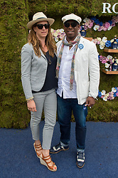Former England and Arsenal footballer Ian Wright and his wife Nancy Hallam arrive at the Royal Salute Coronation Cup polo at Windsor Great Park in Surrey.