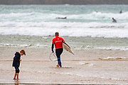 Adrian Napper walks out for his heat in the Boardmasters Longboard Pro at Fistral Beach, Newquay, Cornwall, United Kingdom on 10 August 2019.