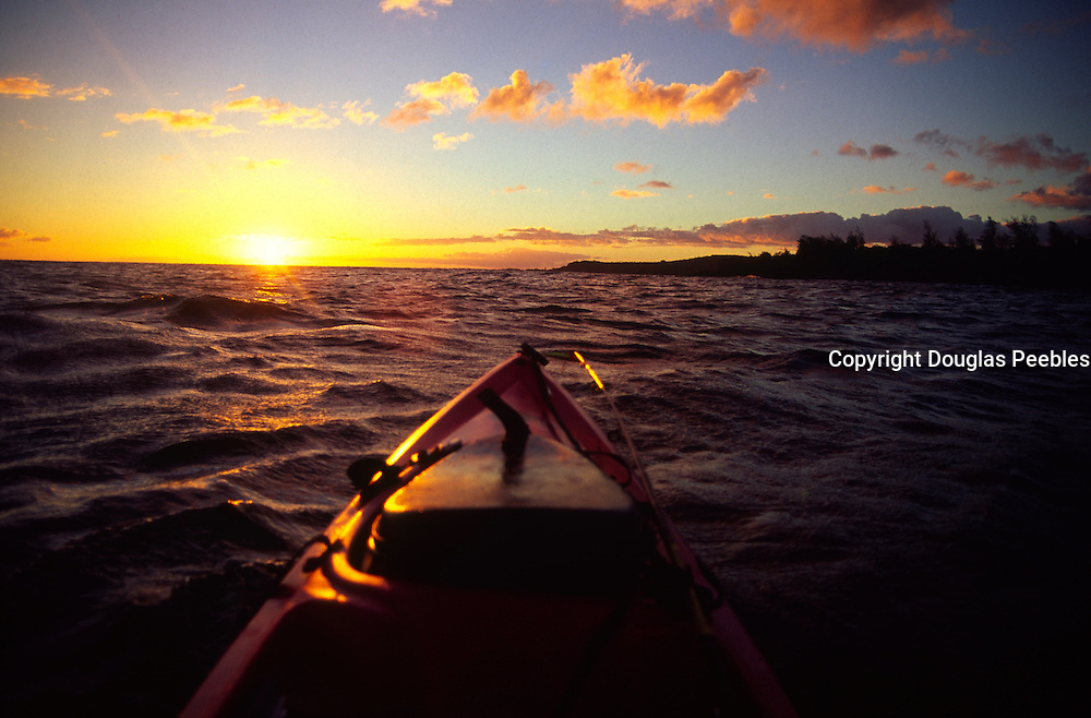 Kayaking at sunset, Hawaii<br />