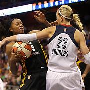 Roneeka Hodges, (left), Tulsa Shock, is blocked by Katie Douglas, Connecticut Sun, during the Connecticut Sun Vs Tulsa Shock WNBA regular season game at Mohegan Sun Arena, Uncasville, Connecticut, USA. 3rd July 2014. Photo Tim Clayton