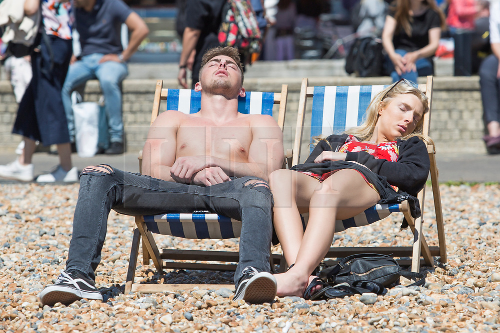 © Licensed to London News Pictures. 10/06/2017. Brighton, UK. Members of the public enjoy the sunny weather by spending the Saturday afternoon on the beach in Brighton and Hove. Photo credit: Hugo Michiels/LNP