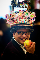 © Licensed to London News Pictures. 14/03/2017. LONDON, UK.  London Book Fair. In this picture: Author CHITO SALARZA-GRANT wearing a flamboyant 'Reading is Fun' hat to attract attention to his latest book.  Photo credit: Cliff Hide/LNP
