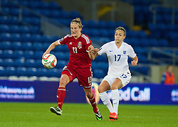 CARDIFF, WALES - Tuesday, August 21, 2014: Wales' Carys Hawkins in action against England's Jodie Taylor during the FIFA Women's World Cup Canada 2015 Qualifying Group 6 match at the Cardiff City Stadium. (Pic by David Rawcliffe/Propaganda)