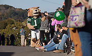 Rufus high-fives people during the homecoming parade.