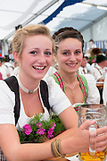 Young girl with villagers at beer festival in the village of Klais in Bavaria, Germany