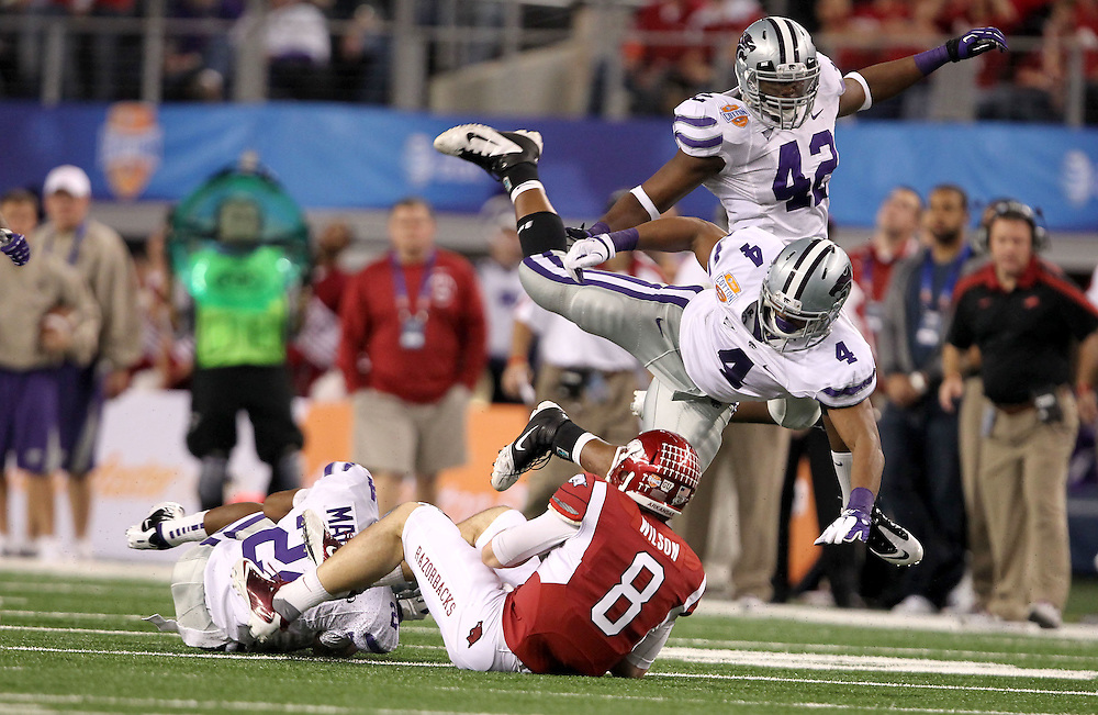 Kansas Sate Arthur Brown (4) and Meshak Williams (42) take down Arkansas quarterback Tyler Wilson (8) during the 2012 AT&T Cotton Bowl game between Arkansas and Kansas State at Cowboy Stadium in Arlington, Tx. on Jan 6th, 2012.