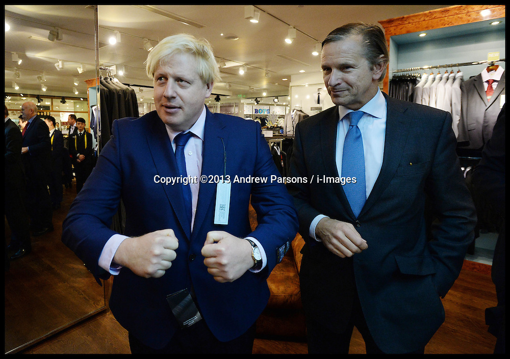 The London Mayor Boris Johnson trying on a Saville Row Jacket in M&S in Shanghai with Marc Bolland Chief Executive of M&S on Day 4 of his Trade Mission to China, Wednesday, 16th October 2013. Picture by Andrew Parsons / i-Images