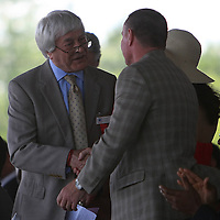 The London Sun boxing writer Colin Hart, shakes hands with Micky Ward on stage during the 2013 International Boxing Hall of Fame induction ceremony on Sunday, June 9, 2013 in Canastota, New York.  (AP Photo/Alex Menendez)