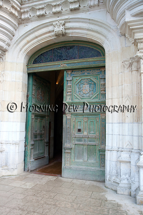 An ornate carved door invites visitors to Chateau Chenonceau in France's Loire Valley.