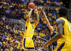 Dec 8, 2018; Morgantown, WV, USA; West Virginia Mountaineers forward Esa Ahmad (23) shoots a three pointer during the second half against the Pittsburgh Panthers at WVU Coliseum. Mandatory Credit: Ben Queen-USA TODAY Sports