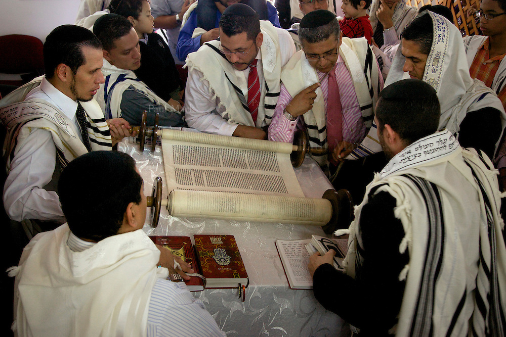 BELLO, COLOMBIA - November 4: The congregation in Bello gathers round the Torah, a 120-year-old scroll written in Amsterdam and obtained by the community five years ago.