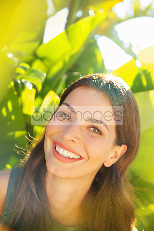 Smiling Woman with Palm Leaves in background