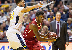 Jan 18, 2017; Morgantown, WV, USA; Oklahoma Sooners guard Rashard Odomes (1) looks to pass while guarded by West Virginia Mountaineers forward Esa Ahmad (23) late in the second half at WVU Coliseum. Mandatory Credit: Ben Queen-USA TODAY Sports