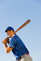 Baseball player swinging baseball bat (low angle view)