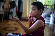 "Bangkok November 13, 2013<br /> Kafille is 6 years old. His mother had noticed since he was 3 years old, he already behaved as a little girl, showing signs of being feminine. His older brother, Aekachai, 23, is a ladyboy, and Kafille was definitely influenced by him.As her mother said: ""we can't do anything, he has to follow his heart and has to live his life the way he wants to""