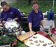 Setting out samples at the Kohler Catering booth during the 21st annual The Taste in the Lincoln Park Commons area at the Fraze Pavilion, Thursday, September 3, 2009.