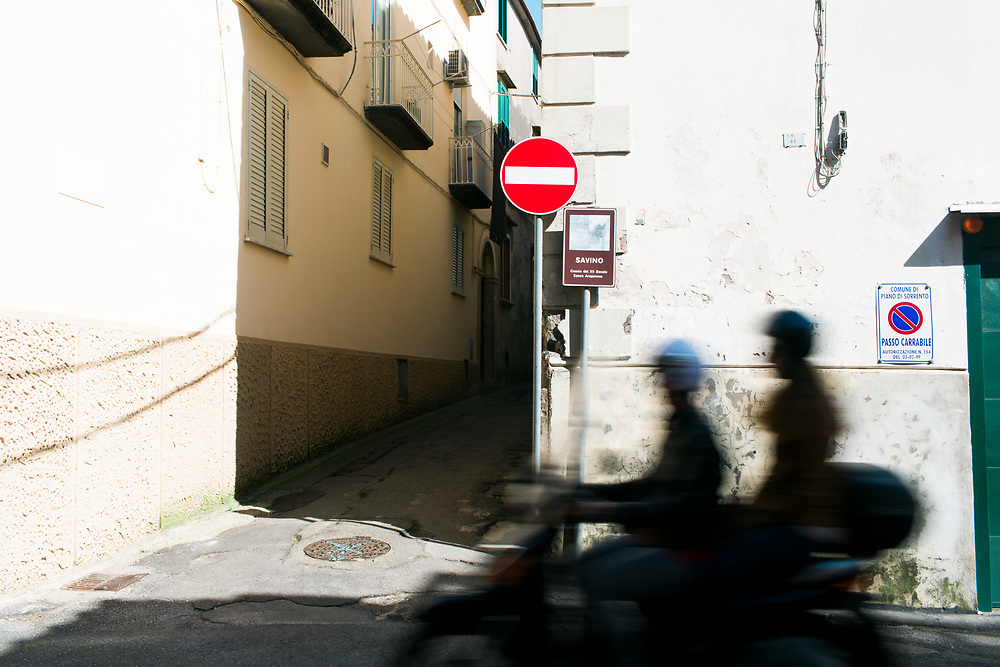 Scooter speeds along coast in Piano di Sorrento