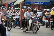 Hanoi, Vietnam, October 2008. Busy traffic in the streets of Hanoi, as motorbikes, scooters, bicycles, and cyclo's compete for space. Vietnam is an upcoming player in the travel industry. Photo by Frits Meyst/Adventure4ever.com