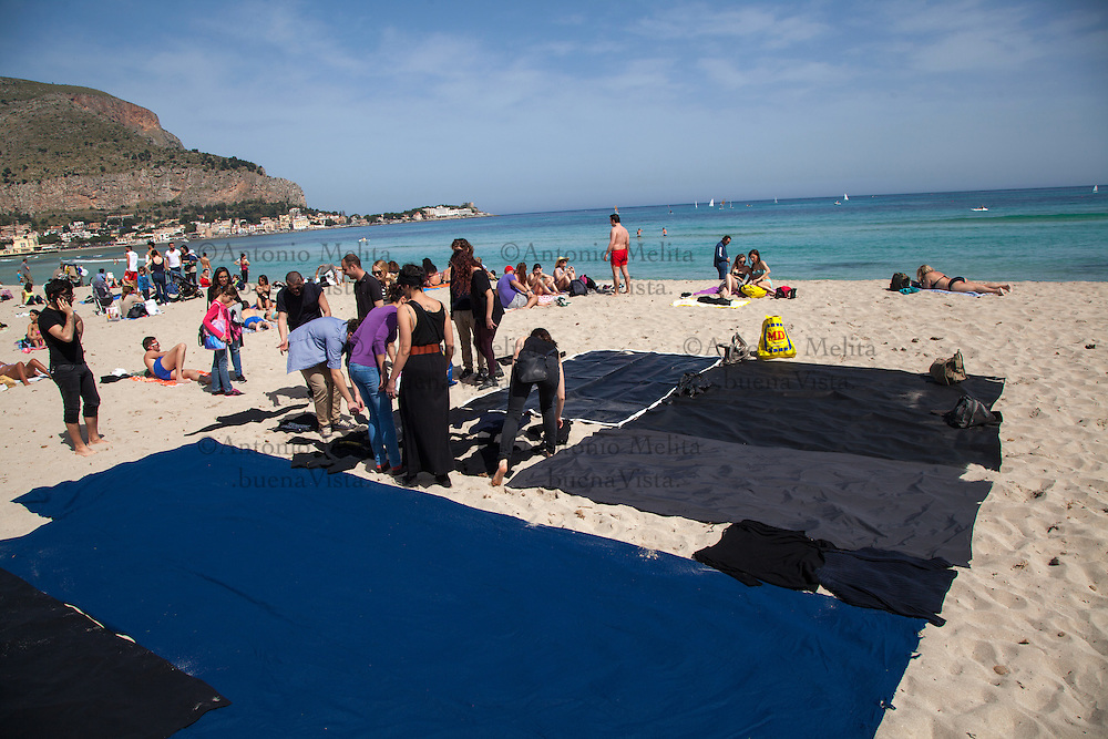 In Mondello Beach, a flash mob organized by activists against plans by international companies to explore for oil in the island's waters.