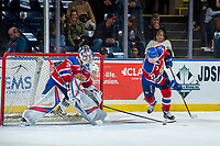 KELOWNA, CANADA - FEBRUARY 17: Dillon Dube #19 of the Kelowna Rockets skates behind the net  of Todd Scott #35 and stick checks Conner McDonald #37 of the Edmonton Oil Kings  on February 17, 2018 at Prospera Place in Kelowna, British Columbia, Canada.  (Photo by Marissa Baecker/Shoot the Breeze)  *** Local Caption ***