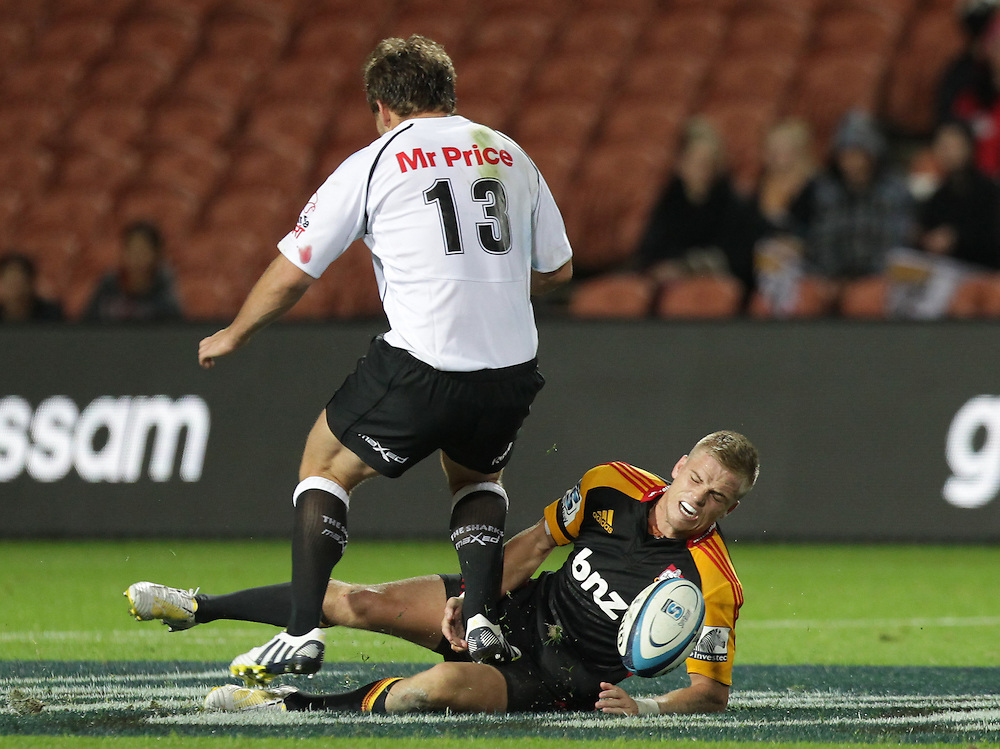 Chiefs' Gareth Anscombe receives a painful kick from Sharks' Francois Steyn in a Super Rugby match, Waikato Stadium, Hamilton, New Zealand, Saturday, April 27, 2013.  Credit:SNPA / David Rowland
