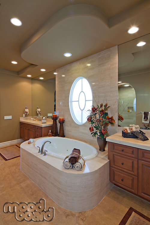 Bath and sink with circular window in luxurious bathroom