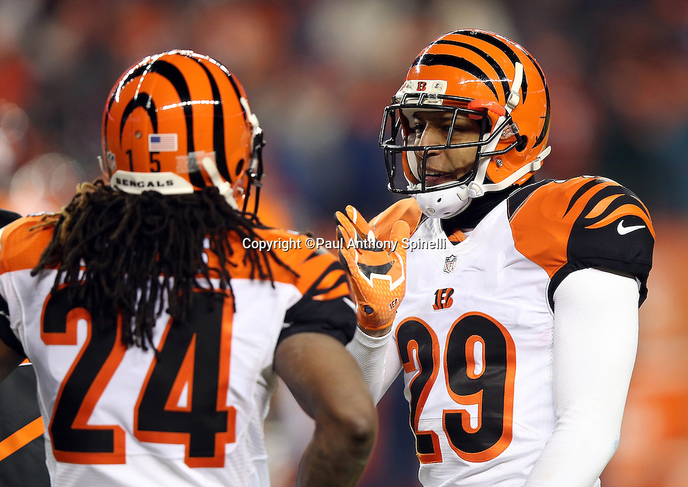 Cincinnati Bengals strong safety Leon Hall (29) gestures with his hand as he talks to Cincinnati Bengals cornerback Adam Jones (24) between plays during the 2015 NFL week 16 regular season football game against the Denver Broncos on Monday, Dec. 28, 2015 in Denver. The Broncos won the game in overtime 20-17. (©Paul Anthony Spinelli)