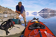 EAST GREENLAND, Sea Kayaking, portrait of paddler and boat