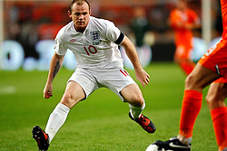 Wayne Rooney defends during the International Friendly between Netherlands and England at the Amsterdam Arena on August 12, 2009 in Amsterdam, Netherlands.