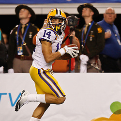 Jan 7, 2011; Arlington, TX, USA; LSU Tigers cornerback Tyrann Mathieu (14) runs back an interception against the Texas A&M Aggies during the fourth quarter of the 2011 Cotton Bowl at Cowboys Stadium. LSU defeated Texas A&M 41-24.  Mandatory Credit: Derick E. Hingle