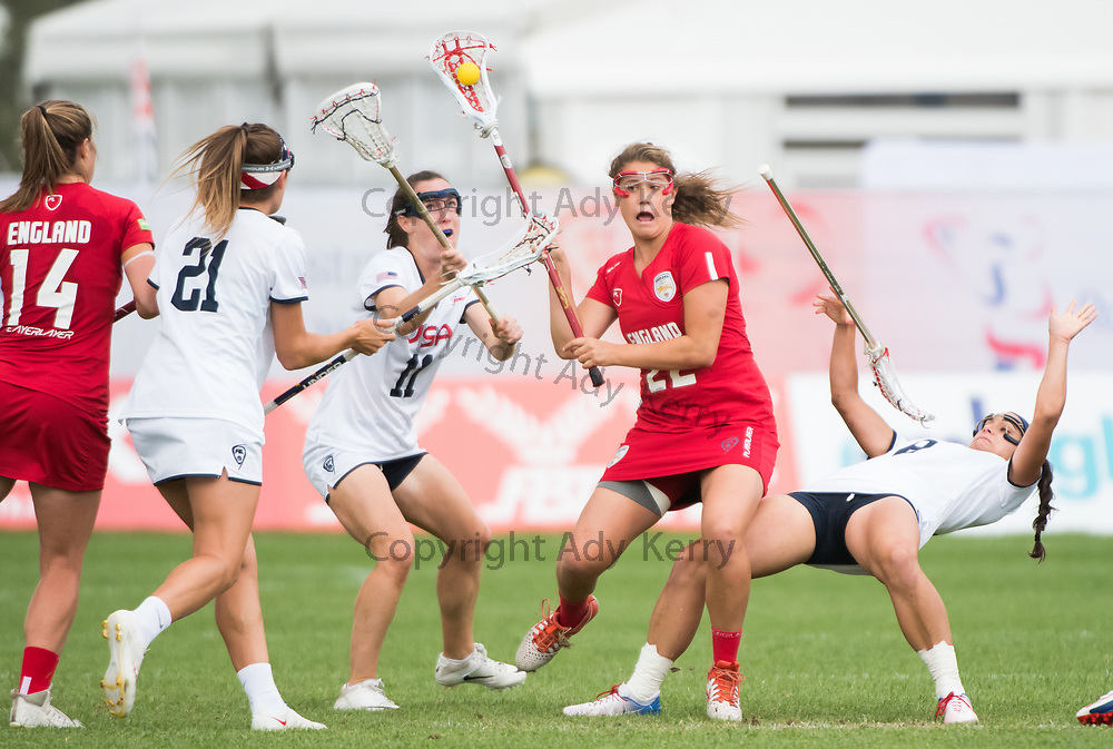 England's Olivia Hompe(22) shows determination against the USA at the 2017 FIL Rathbones Women's Lacrosse World Cup at Surrey Sports Park, Guilford, Surrey, UK, 15th July 2017
