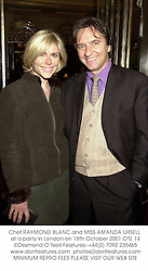 Chef RAYMOND BLANC and MISS AMANDA URSELL at a party in London on 18th October 2001.	OTE 14