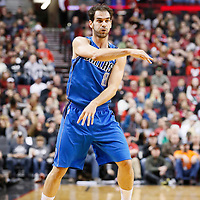 07 December 2013: Dallas Mavericks point guard Jose Calderon (8) passes the ball during the Dallas Mavericks 108-106 victory over the Portland Trail Blazers at the Moda Center, Portland, Oregon, USA.