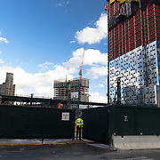 Worker enters site during foundation work on the future home of Court Square City View Tower in Long Island City.  The tower is projected to be the tallest structure in Queens rising to a height of 964 feet when it is completed in 2019