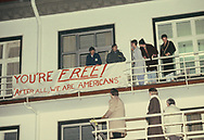 Hostages in Germany after release.   Hostages wave from balcony as President Jimmy Carter visits other hostages at Rhein-Main Air Base hospital on January 21, 1980.<br /> Photo by Dennis Brack