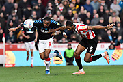 Britt Assombalonga (9) of Middlesbrough battles for possession with Ethan Pinnock (5) of Brentford during the EFL Sky Bet Championship match between Brentford and Middlesbrough at Griffin Park, London, England on 8 February 2020.