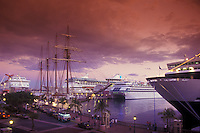 Red dusk view of cruise ships and tall ship docked at SJ harbor.