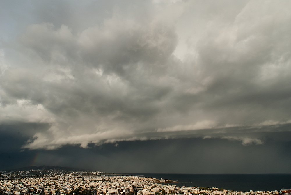 A wall of rain moves onteh city of Chania.  A thunderstorm approaches the city from the sea.