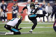 Jacksonville Jaguars punter Brad Nortman (3) holds while Jacksonville Jaguars kicker Josh Lambo (4) kicks a 54 yard field goal good for a 17-10 third quarter Jaguars lead during the AFC Championship NFL playoff football game against the New England Patriots, Sunday, Jan. 21, 2018 in Foxborough, Mass. The Patriots won the game 24-20. (©Paul Anthony Spinelli)