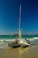 Young boys of Maagan michael flotilla is handelling a boat on shore