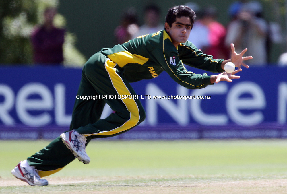Pakistan bowler Babar Azam fields his own bowling. Australia v Pakistan, U19 Cricket World Cup Final, Bert Sutcliffe Oval, Lincoln, Christchurch, Saturday 30th January 2010. Photo : PHOTOSPORT