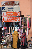 Two women shopping on a street in the medina of Marrakech, Morocco.
