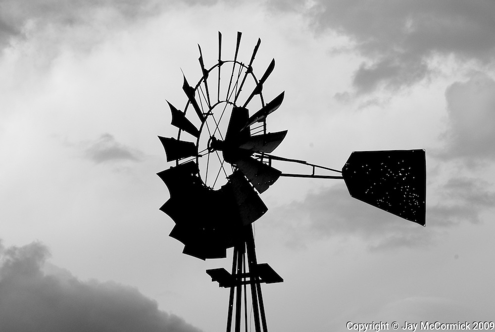 Windmill in Pasture in Baylor Canyon, Just outside of Las Cruces, NM.  Black and White with bullet riddled fin