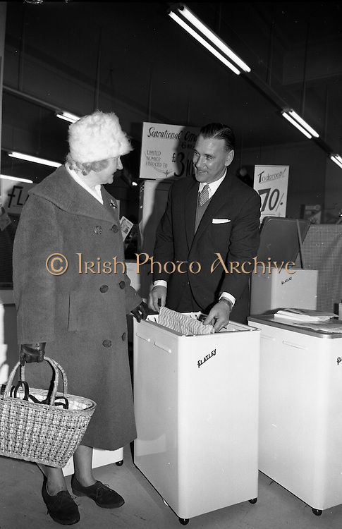 A demonstration of the Flatley Dryer at Todco Ltd. Basically a metal cabinet with a heater unit at the base and removable wooden slats for hanging clothes at the top, the clothes dryer was very popular for many years, and for a time was manufactured in Bantry, Co Cork. .14.03.1963